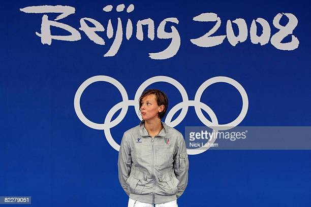 Federica Pellegrini of Italy waits to receive the gold medal during the medal ceremony for the Women's 200m Freestyle held at the National Aquatics...