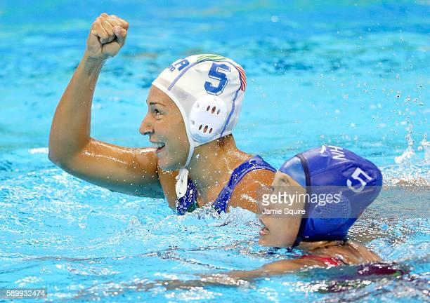 Federica Radicchi of Italy celebrates after scoring a goal as Guannan Niu of China defends during their quarterfinal match at the Rio 2016 Olympic...