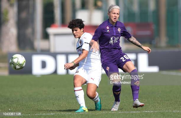 Federica Rizza of AC Milan is challenged by Lana Clelland of Fiorentina Women's FC during the Serie A match between AC Milan Women and Fiorentina...