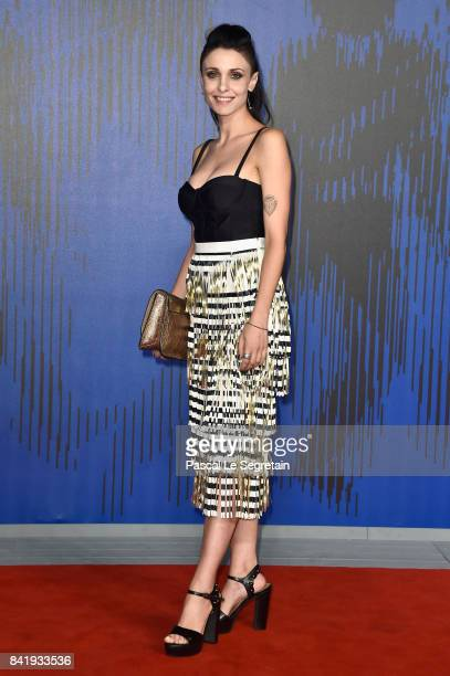 Federica Vincenti walks the red carpet ahead of the 'Suburra. La Serie' screening during the 74th Venice Film Festival at Sala Giardino on September...