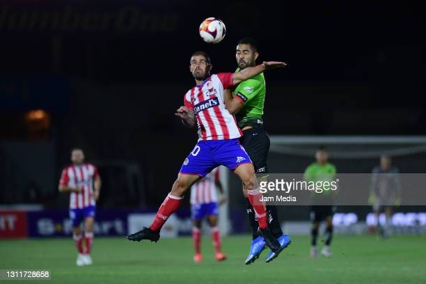 Federico Acevedo of San Luis fights for the ball with Jose Esquivel of Juarez during the 14th round match between FC Juarez and Atletico San Luis as...