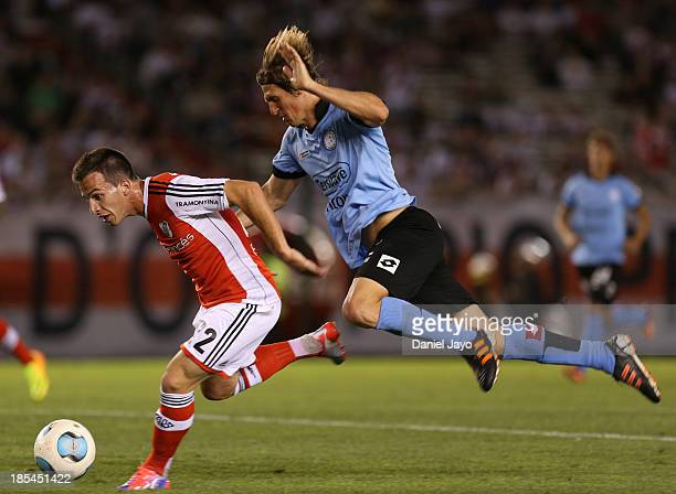 Federico Andrada of River Plate and Esteban Gonzalez of Belgrano fight for the ball during a match between River Plate and Belgrano as part of the...