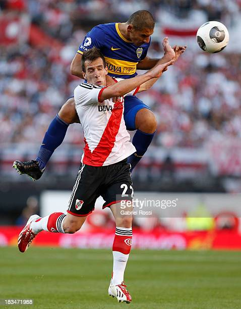 Federico Andrada of River Plate fights for the ball with Daniel Diaz of Boca Juniors during a match between River Plate and Boca Juniors as part of...