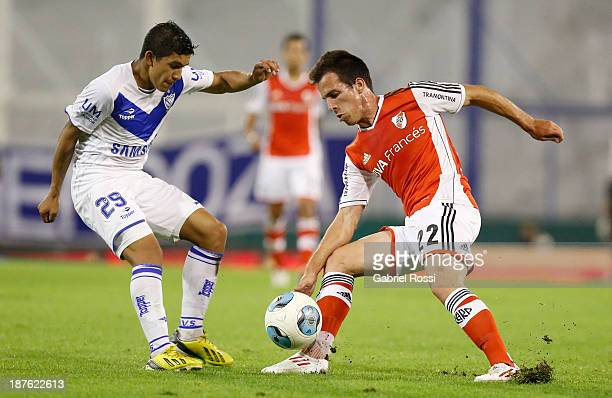 Federico Andrada of River Plate fights for the ball with Lucas Romero of Velez Sarsfield during a match between Velez Sarsfield and River Plate as...