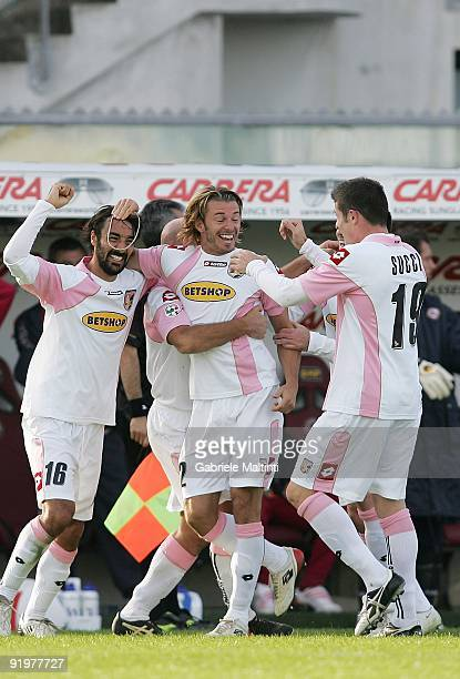 Federico Balzaretti of Palermo is congratulated after scoring the second goal during the Serie A Tim match between AS Livorno Calcio and US Citta' di...