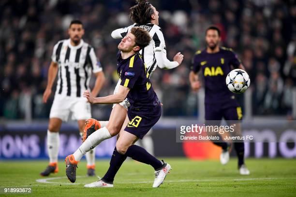 Federico Bernardeschi and Ben Davies during the UEFA Champions League Round of 16 First Leg match between Juventus and Tottenham Hotspur at Allianz...
