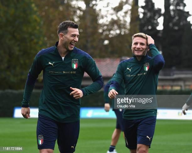 Federico Bernardeschi and Ciro Immobile of Italy smile during a Italy training session at Centro Tecnico Federale di Coverciano on November 11, 2019...