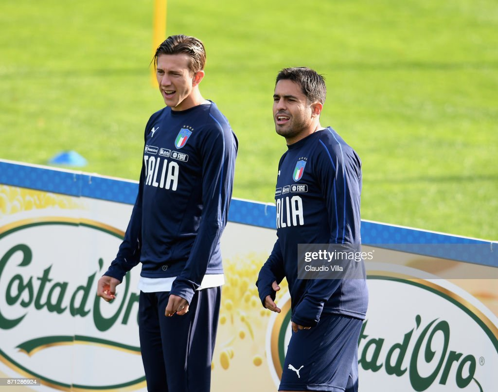 Federico Bernardeschi (L) and Citadin Martins Eder of Italy look on during a training session at Italy club's training ground at Coverciano on November 7, 2017 in Florence, Italy.