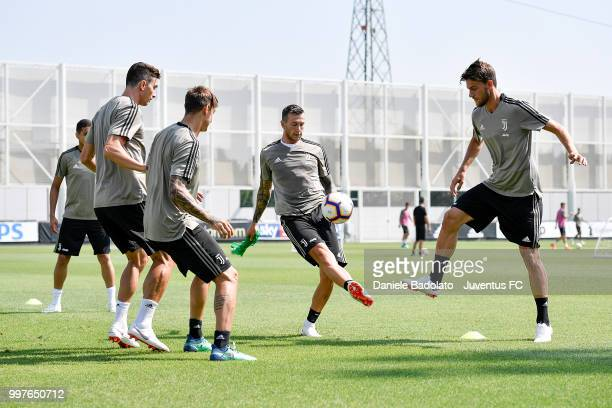 Federico Bernardeschi and Daniele Rugani during a Juventus training session at Juventus Training Center on July 13 2018 in Turin Italy