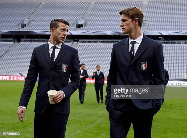 Federico Bernardeschi and Daniele Rugani of Italy chat at the Allianz Arena on March 28 2016 in Munich Germany