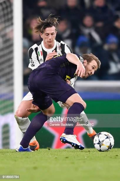 Federico Bernardeschi and Harry Kane during the UEFA Champions League Round of 16 First Leg match between Juventus and Tottenham Hotspur at Allianz...