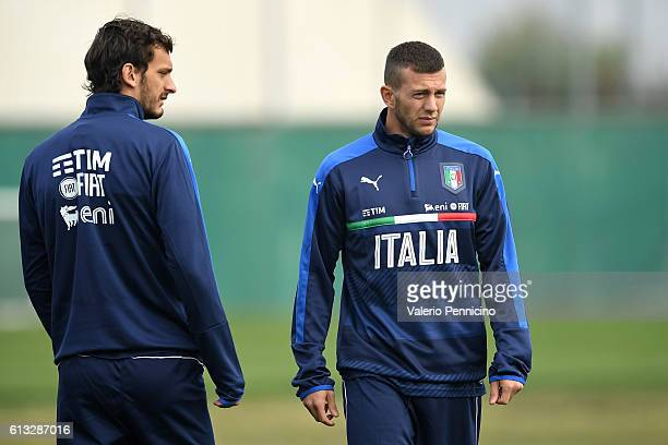 Federico Bernardeschi and Manolo Gabbiadini of Italy look on during an Italy training session at Juventus Center Vinovo on October 8 2016 in Vinovo...