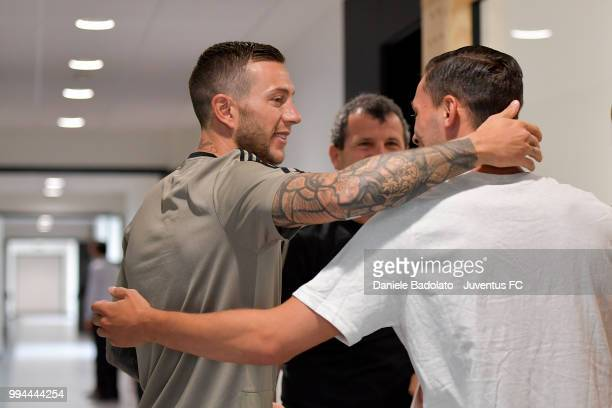 Federico Bernardeschi and Mattia De Sciglio attend a Juventus training session at Juventus Training Center on July 9 2018 in Turin Italy