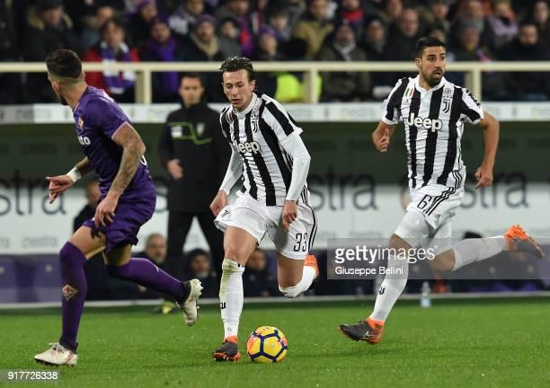 Federico Bernardeschi and Sami Khedira of Juventus in action during the serie A match between ACF Fiorentina and Juventus at Stadio Artemio Franchi...
