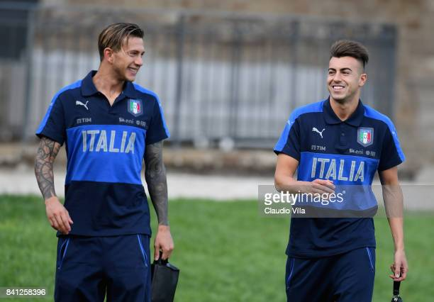 Federico Bernardeschi and Stephan El Shaarawy of Italy chat during the training session at Italy club's training ground at Coverciano on August 31...