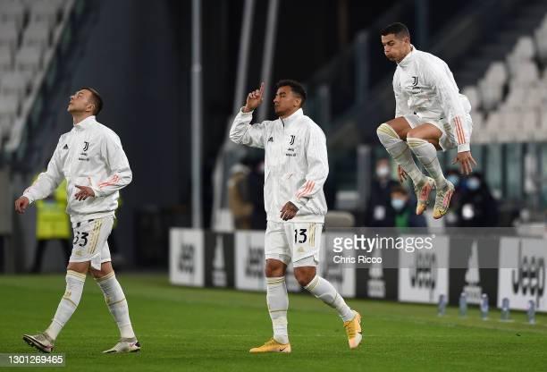 Federico Bernardeschi, Danilo and Cristiano Ronaldo of Juventus walk onto the pitch prior to the Coppa Italia semi-final Juventus and FC...