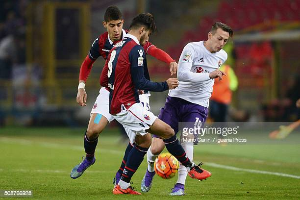 Federico Bernardeschi of ACF Fiorentina competes the ball with Saphir Taider of Bologna FC during the Serie A match between Bologna FC and ACF...
