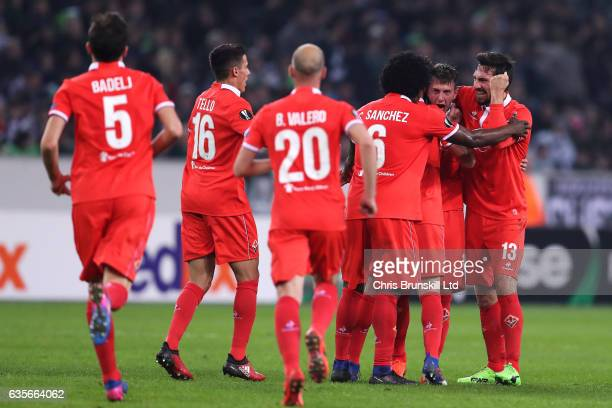 Federico Bernardeschi of ACF Fiorentina is congratulated by his team-mates after scoring the opening goal during the UEFA Europa League Round of 32...
