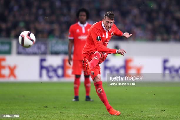 Federico Bernardeschi of ACF Fiorentina scores the opening goal during the UEFA Europa League Round of 32 first leg match between Borussia...