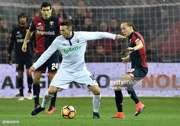 Federico Bernardeschi of Fiorentina and Diego Laxalt of Genoa during the Serie A match between Genoa CFC and ACF Fiorentina at Stadio Luigi Ferraris...