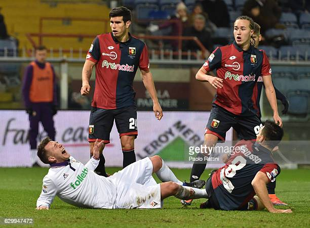 Federico Bernardeschi of Forentina stopped by Nicolas Burdisso of Genoa during the Serie A match between Genoa CFC and ACF Fiorentina at Stadio Luigi...