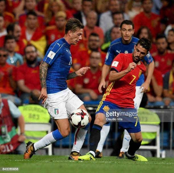 Federico Bernardeschi of Italy and David Villa of Spain compete for the ball during the FIFA 2018 World Cup Qualifier between Spain and Italy at...