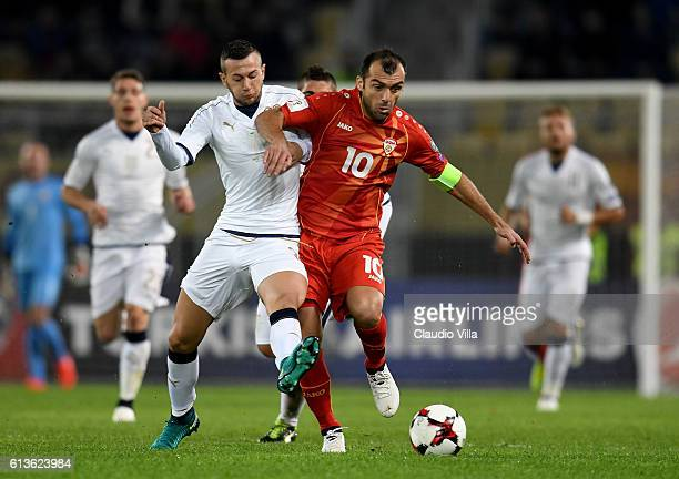 Federico Bernardeschi of Italy and Goran Pandev of FYR Macedonia compete for the ball during the FIFA 2018 World Cup Qualifier between FYR Macedonia...