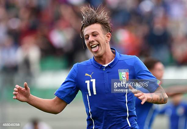 L'AQUILA ITALY SEPTEMBER 09 Federico Bernardeschi of Italy celebrates after scoring a goal during the 2015 UEFA European U21 Championships Qualifier...