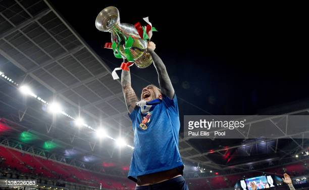 Federico Bernardeschi of Italy celebrates with The Henri Delaunay Trophy following his team's victory in the UEFA Euro 2020 Championship Final...