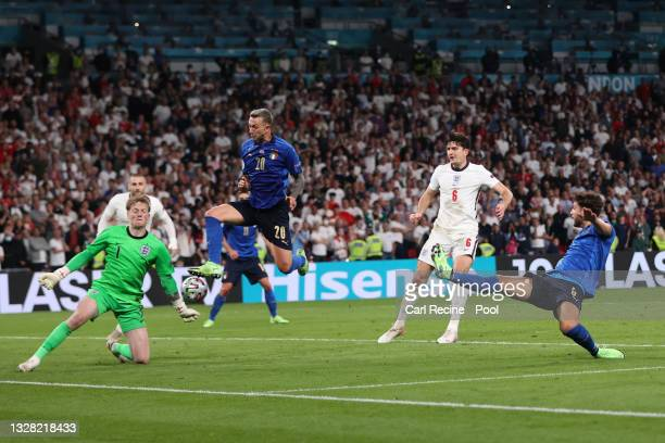Federico Bernardeschi of Italy is challenged by Jordan Pickford of England during the UEFA Euro 2020 Championship Final between Italy and England at...