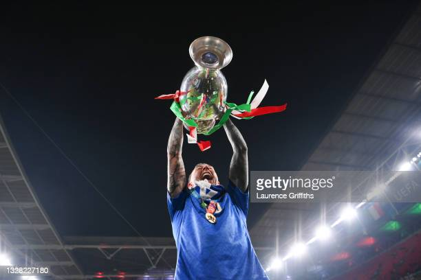 Federico Bernardeschi of Italy lifts The Henri Delaunay Trophy following his team's victory in the UEFA Euro 2020 Championship Final between Italy...