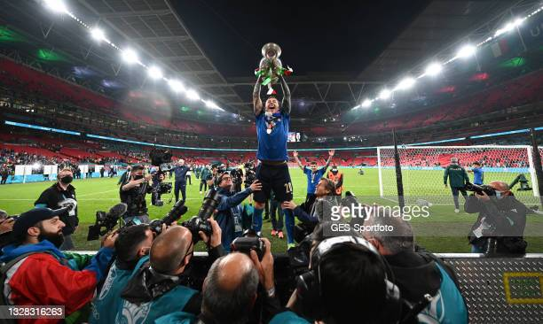 Federico Bernardeschi of Italy lifts the Henri Delaunay Trophy following his team's victory in during the UEFA Euro 2020 Championship Final between...