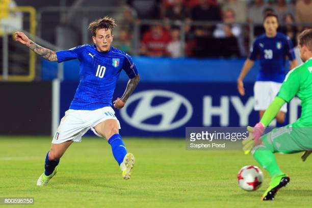 Federico Bernardeschi of Italy scores their first goal past Jannik Pollersbeck of Germany during the 2017 UEFA European Under21 Championship Group C...