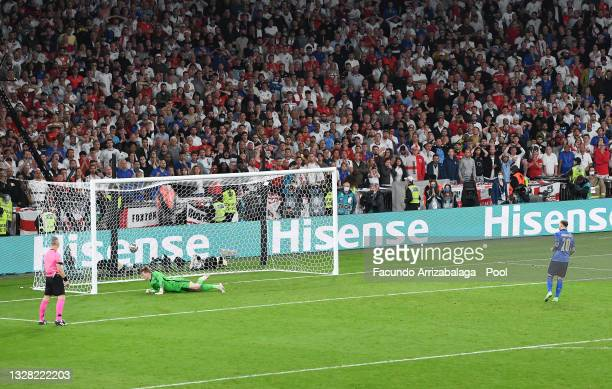 Federico Bernardeschi of Italy scores their team's fourth penalty in a penalty shoot out past Jordan Pickford of England during the UEFA Euro 2020...