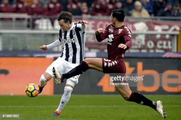 Federico Bernardeschi of Juventus and Nicolas Burdisso of Torino during the serie A match between Torino FC and Juventus at Stadio Olimpico di Torino...