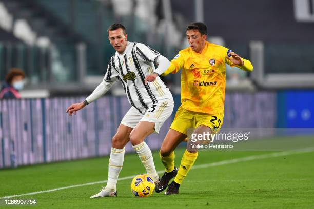 Federico Bernardeschi of Juventus battles for possession with Gabriele Zappa of Cagliari Calcio during the Serie A match between Juventus and...