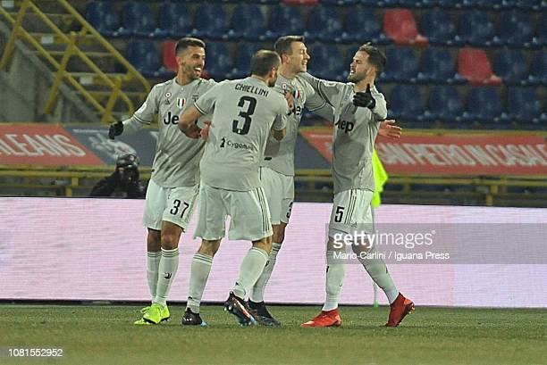 Federico Bernardeschi of Juventus celebrates after scoring the opening goal during the Coppa Italia match between Bologna FC and Juventus at Stadio...