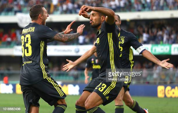 Federico Bernardeschi of Juventus celebrates his goal with his team-mate Emre Can during the serie A match between Chievo Verona and Juventus at...