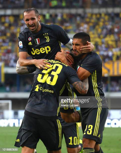 Federico Bernardeschi of Juventus celebrates his goal with his teammates Emre Can and Giorgio Chiellini during the serie A match between Chievo...