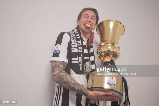Federico Bernardeschi of Juventus celebrates with the trophy after winning the TIM Cup Final between Juventus and AC Milan at Stadio Olimpico on May...