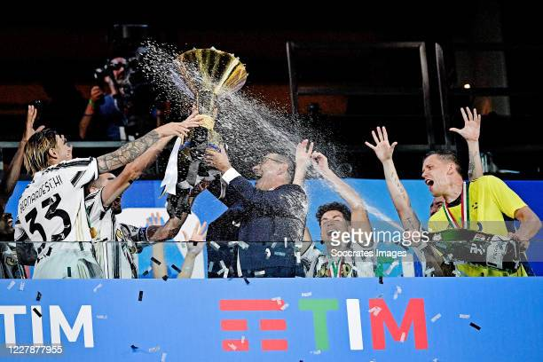 Federico Bernardeschi of Juventus, coach Maurizio Sarri of Juventus, Wojciech Szczesny of Juventus celebrates the championship with the trophy during...