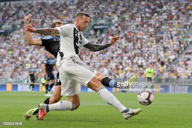 Federico Bernardeschi of Juventus competes for the ball during the serie A match between Juventus and SS Lazio on August 25 2018 in Turin Italy