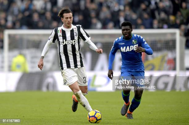 Federico Bernardeschi of Juventus competes for the ball with Alfred Duncan of Sassuolo during the serie A match between Juventus and US Sassuolo on...