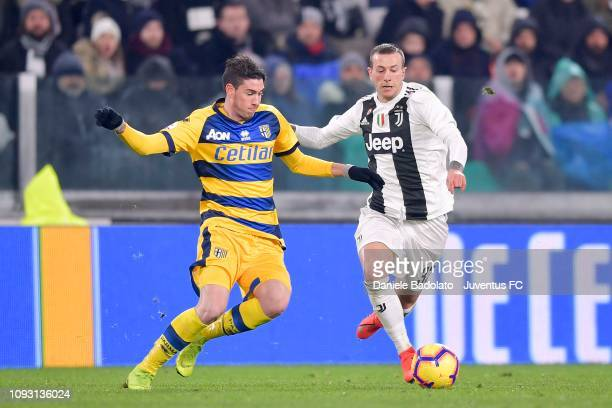 Federico Bernardeschi of Juventus competes for the ball with Alessandro Bastoni of Parma Calcio during the Serie A match between Juventus and Parma...
