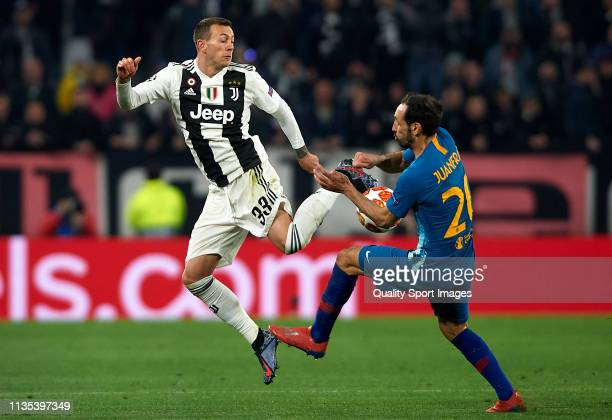 Federico Bernardeschi of Juventus competes for the ball with Juanfran Torres of Atletico de Madrid during the UEFA Champions League Round of 16...