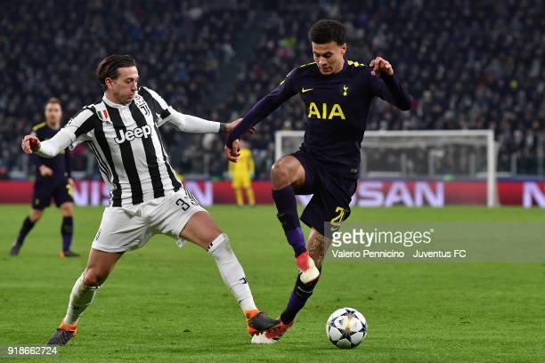 Federico Bernardeschi of Juventus competes with Dele Alli of Tottenham Hotspur during the UEFA Champions League Round of 16 First Leg match between...
