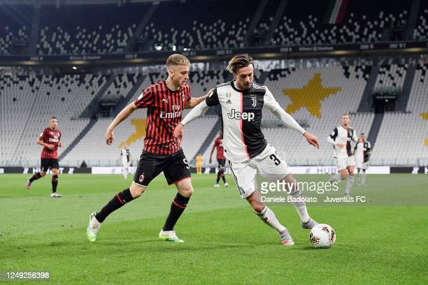 Federico Bernardeschi of Juventus controls the ball under pressure from Alexis Saelemaekers of AC Milan during the Coppa Italia Semi-Final Second Leg...