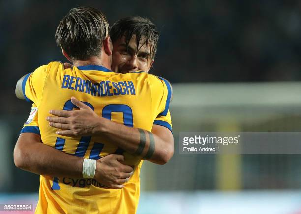Federico Bernardeschi of Juventus FC celebrates with his teammate Paulo Dybala after scoring the opening goal during the Serie A match between...