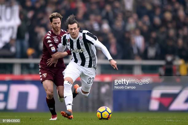 Federico Bernardeschi of Juventus FC competes for the ball with Cristian Ansaldi of Torino FC during the Serie A football match between Torino FC and...