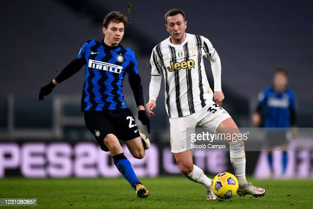Federico Bernardeschi of Juventus FC is challenged by Nicolo Barella of FC Internazionale during the Coppa Italia football match between Juventus FC...